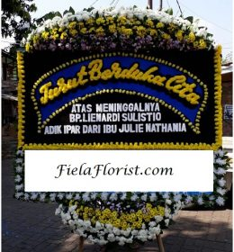 Bunga Papan Jakarta Ucapan Duka Cita FF-140 bagian dari kepedulian anda serta rasa duka yang mendalam terhadap keluarga yang ditinggalkan.